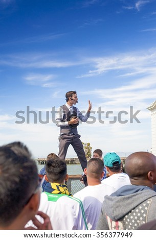 San-Francisco-United States, July 13, 2014: Positive Caucasian Male Street Artist Performing Outdoors on San-Francisco Pier on July 13, 2014 in San-Francisco, California, United States of America - stock photo