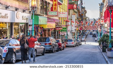 SAN FRANCISCO, US - AUGUST 1, 2014:  Tourists making a photograph of Chinatown with their phone in San Francisco US - stock photo