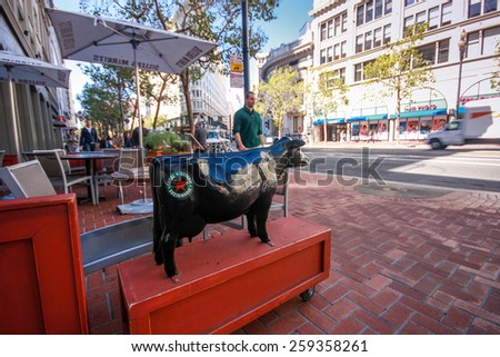SAN FRANCISCO, US - SEPT 22, 2010: Entrance to restaurant declared its food to be organic local and sustainable on plastic cow body in San Francisco on Sept 22, 2010. - stock photo