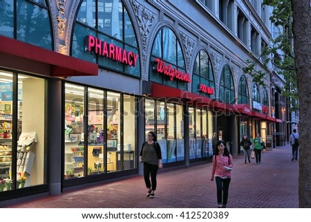 SAN FRANCISCO, USA - APRIL 8, 2014: People walk by Walgreens pharmacy and food mart in San Francisco, USA. Walgreen Co is the largest drugstore chain in the USA by sales. - stock photo