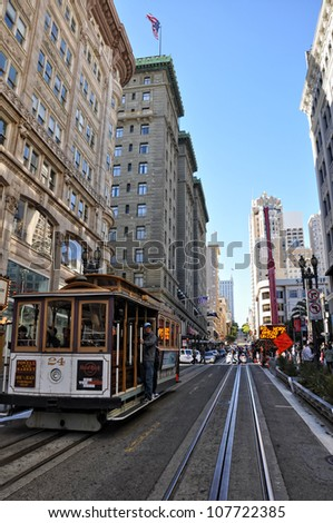 SAN FRANCISCO, USA - AUGUST 15:  tourists on a cable car on August 15, 2011 in Francisco. Cable cars in San Francisco are in service since 1873 and carry 10 million passengers per year - stock photo