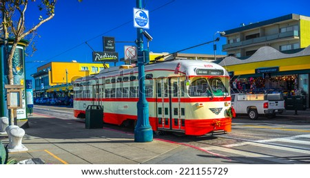SAN FRANCISCO, USA - DECEMBER 16: F Market e Wharves rail line on Dec 16, 2013 in San Francisco. the F line is operated as a heritage streetcar service, using exclusively historic equipment. - stock photo