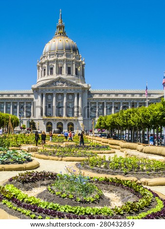 SAN FRANCISCO, USA - JULY 23, 2008: people visit the garden in front of City Hall in San Francisco, USA. San Francisco City Hall is the seat of government for the City and County of San Francisco. - stock photo