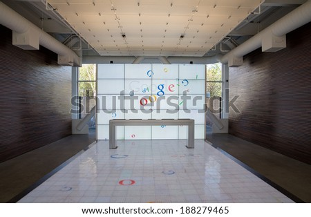 San Francisco, USA - MARCH 19: Symmetrical composition of the screens with Google logos at googles headquarters in Mountain View, on March 19, 2014 in San Francisco, USA. - stock photo