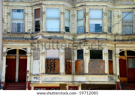 San Francisco wooden victorian houses boarded up and derelict. - stock photo