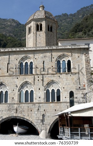 San Fruttuoso beach and Abbey facade. The main construction of the building remains from Romanesque times with characteristic windows. Protected Marine Area of Portofino - Liguria Italy - stock photo