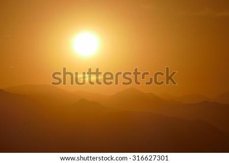 San Gabriel Mountains sunrise viewed from Rocky Peak Park near Los Angeles, California.   - stock photo