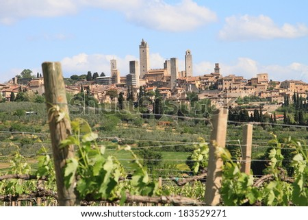 San Gimignano castle and vineyards in Tuscany, Italy, a UNESCO world heritage site  - stock photo