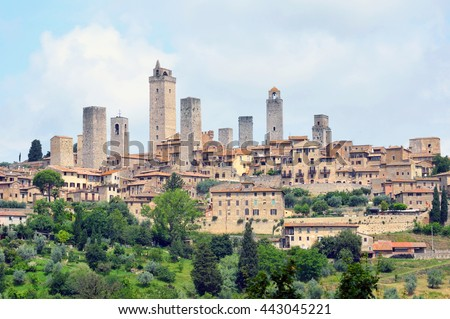 SAN GIMIGNANO, ITALY - JUNE 9 2016: San Gimignano is a walled hill town and there are 14 medieval tower houses that patrician families built as symbols of their wealth and power.
