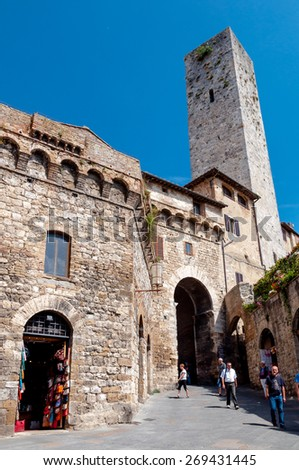 San Gimignano Italy on September il 07 2014. Tourists visit Torre dei Becchi in this traditional Italian city - stock photo
