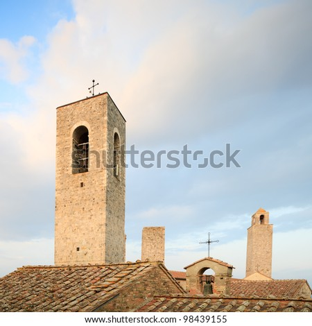 San Gimignano landmark medieval town, Tuscany, Italy, Europe. Old roof, bell and towers. - stock photo