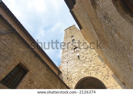 San Gimignano Tower with clouds - stock photo