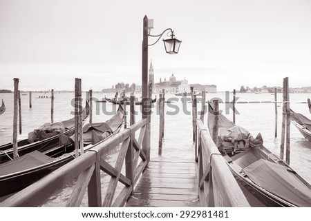 San Giorgio Maggiore Church and Bell Tower and Lamppost, Venice, Italy in Black and White Sepia Tone - stock photo