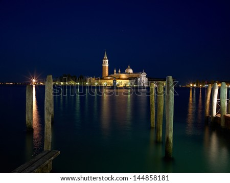 San Giorgio Maggiore church Long exposure By Night. Blurred motion due to Grand Canal sea movement.  - stock photo