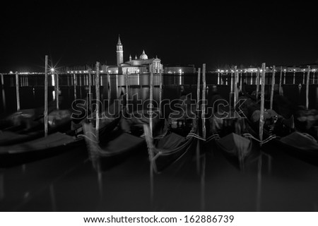 San Giorgio Maggiore church Long exposure By Night. Blurred motion Gondolas due to Grand Canal sea movement. - stock photo