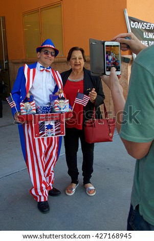 San Jose, CA - May 26, 2016: Vendor from Pop Art Creations posing for a photo with unidentified participant waiting to enter Parkside Hall for the Hillary Clinton political rally.