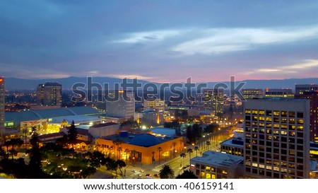 San Jose, Silicon Valley, view of downtown, the Tech Museum, McEnery Convention Center, Silicon Valley, and the Santa Cruz Mountains at sunset. - stock photo
