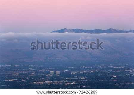 San Jose, the heart of Silicon Valley, seen at dusk with the Diablo mountain range in background - stock photo