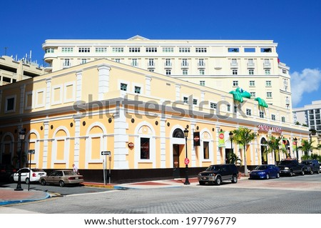 "San Juan, Puerto Rico - January 27th 2012: The famous ""Senor Frog"" shop in old San Juan, Puerto Rico with Sheraton hotel behind"