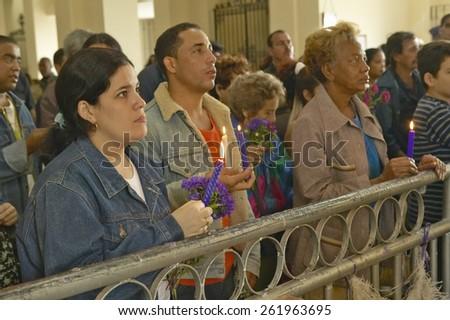 San Lazaro Catholic Church and people praying in El Rincon, Cuba - stock photo