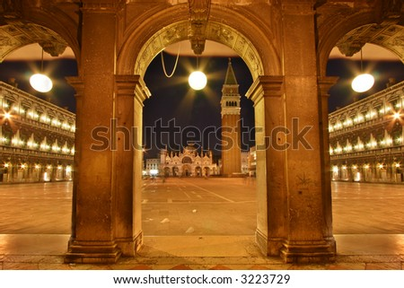 san marco place at night viewed through arch - stock photo