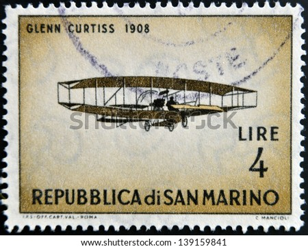 SAN MARINO - CIRCA 1962: A stamp printed in San Marino shows airplane by Glenn Curtiss, 1908, circa 1962 - stock photo