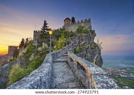 San Marino. Image of castle in San Marino during sunset. - stock photo