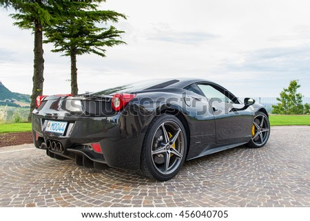 SAN MARINO, ITALY - JUNE 21, 2016: Ferrari 458 rear view. Ferrari S.p.A. is an Italian sports car manufacturer, founded by Enzo Ferrari in 1939. Illustrative editorial.