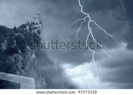 san marino' s tower under the storm
