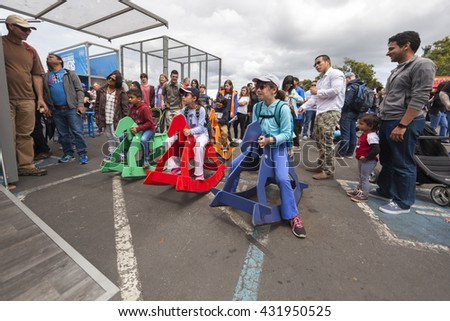 SAN MATEO, CA May 20 2016 - A group of children virtually race rocking horses during the 11th annual Bay Area Maker Faire at the San Mateo County Event Center. - stock photo