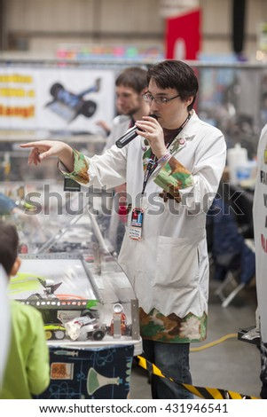 SAN MATEO, CA May 20 2016 - A maker discusses fighting robots at the 11th annual Bay Area Maker Faire at the San Mateo County Event Center. - stock photo