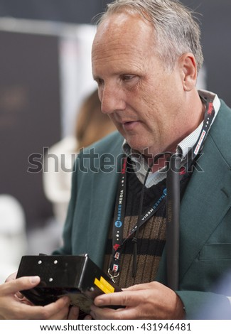 SAN MATEO, CA May 20 2016 - A man explains the workings of a device at the Blind Arduino Project booth during the 11th annual Bay Area Maker Faire at the San Mateo County Event Center. - stock photo