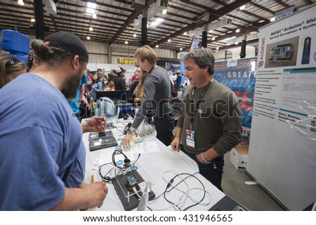 SAN MATEO, CA May 20 2016 - Attendees ask questions during the 11th annual Bay Area Maker Faire at the San Mateo County Event Center. - stock photo