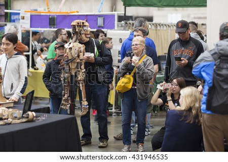 SAN MATEO, CA May 20 2016 - Attendees photograph the uncanny Roy the Robot duringThe 11th annual Bay Area Maker Faire at the San Mateo County Event Center.