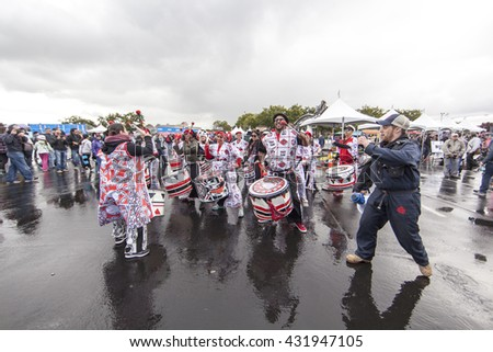SAN MATEO, CA May 20 2016 - Batala warms up the crowd after a rainy start to the Saturday session of the 11th annual Bay Area Maker Faire at the San Mateo County Event Center.