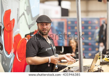 SAN MATEO, CA May 20 2016 - Colin Harrington speaks during the 11th annual Bay Area Maker Faire at the San Mateo County Event Center. - stock photo
