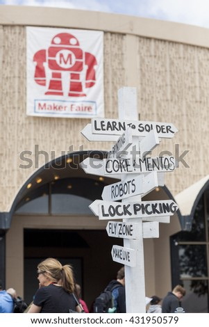 SAN MATEO, CA May 20 2016 - Directional signpost at the 11th annual Bay Area Maker Faire at the San Mateo County Event Center. - stock photo