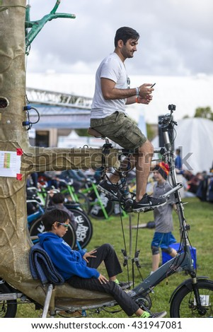 SAN MATEO, CA May 20 2016 - Members of the audience pedal the Tree Bike to power a musical performance during the 11th annual Bay Area Maker Faire at the San Mateo County Event Center.