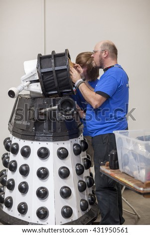 SAN MATEO, CA May 20 2016 - Repair work on a Dalek during the 11th annual Bay Area Maker Faire at the San Mateo County Event Center. - stock photo