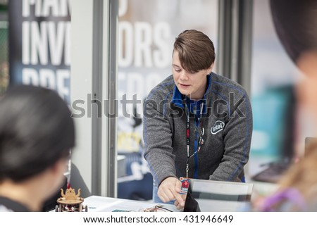 SAN MATEO, CA May 20 2016 - Staff at the Intel sponsor booth assist attendees with activities at the Intel area during the 11th annual Bay Area Maker Faire at the San Mateo County Event Center.