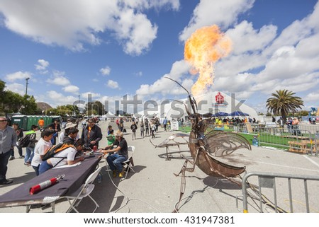SAN MATEO, CA May 20 2016 - Two boys operate an interactive art piece during the 11th Annual Bay Area Maker Faire at the San Mateo County Event Center. - stock photo