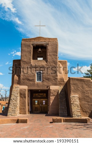 San Miguel Church, Santa Fe, New Mexico. The oldest church structure in America. The original adobe walls and altar were built by Tlaxcalan Indians from Mexico. Circa 1610. - stock photo
