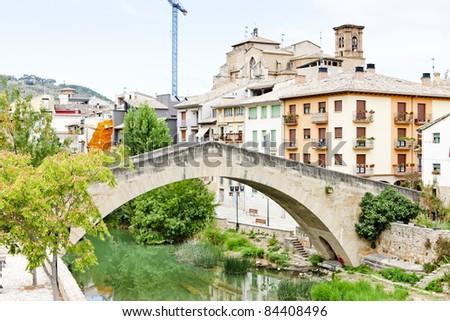 San Miguel church with bridge Puente de la Carcel, Estella, Road to Santiago de Compostela, Navarre, Spain - stock photo