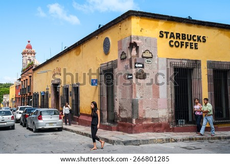 SAN MIGUEL DE ALLENDE, MEXICO-AUG 24, 2008: Starbucks opens a store in this historic colonial town, a UNESCO world heritage site, causing some concern among preservationists. - stock photo