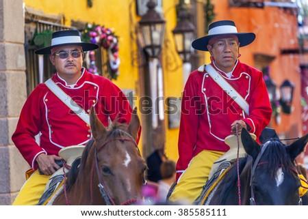 SAN MIGUEL DE ALLENDE, MEXICO - DECEMBER 27, 2014 Mounted Police Traditional Uniforms Jardin Town Square San Miguel de Allende Mexico.  - stock photo