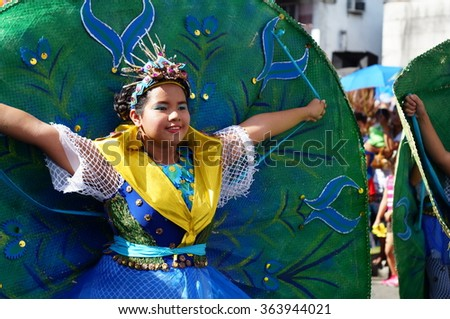 SAN PABLO CITY, LAGUNA, PHILIPPINES - JANUARY 13, 2016: Faces of carnival dancers in various costumes dancing along the road during the 21st annual coconut festival cultural celebration. - stock photo