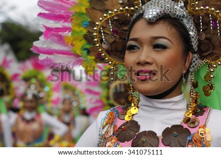 "SAN PABLO CITY, LAGUNA PHILIPPINES - JANUARY 2012: Female street dancer smiles as she dances along Rizal Avenue during the 17th Annual  Coconut Festival Celebration. ""Editorial"""