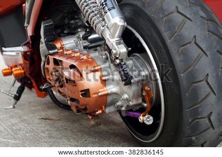 San Pablo City, Laguna, Philippines - September 12, 2015: close up of vintage motorcycle rear wheel, focus tyre - stock photo