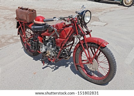 "SAN PATRIZIO, RA,, ITALY - AUGUST 25: an old italian motorcycle Moto Guzzi Sport 14 (1930) at rally ""motoraduno d'epoca San Patrizio 2013"" on August 25, 2013 in San Patrizio, RA,, Italy - stock photo"