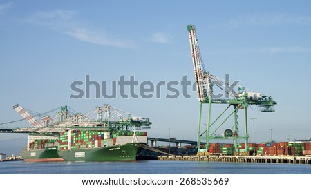 SAN PEDRO, CA - APRIL 08, 2015:. Evergreen Cargo Ships EVER SALUTE and EVER LIBERAL loading at the Port of Los Angeles. The Port of Los Angeles is the busiest container port in the United States. - stock photo